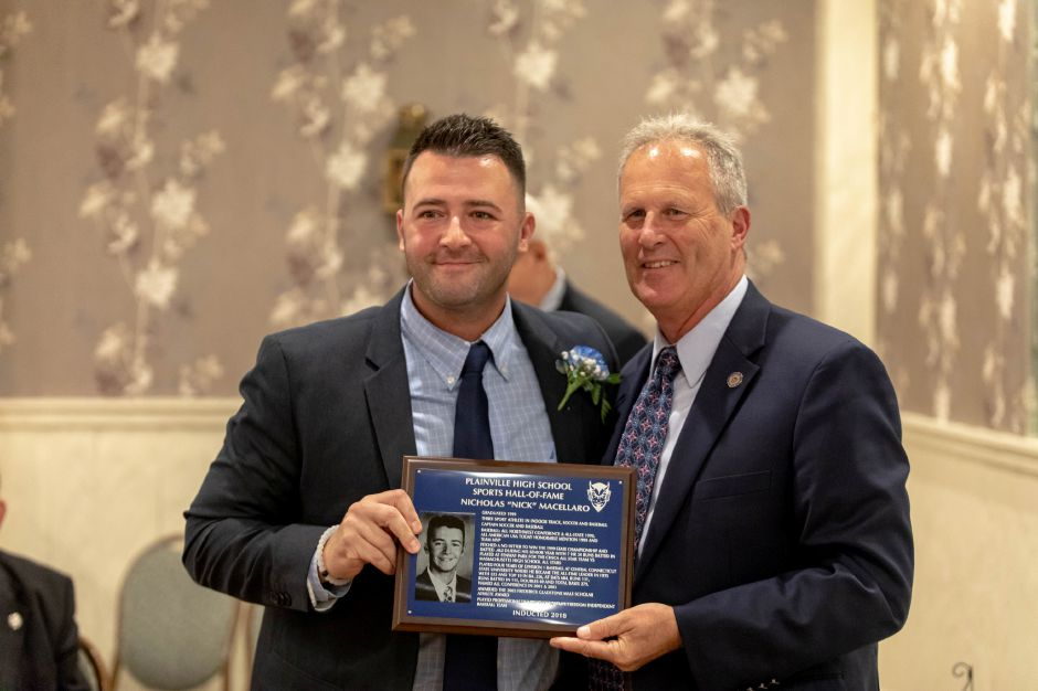 Plainville High School baseball player Nicholas Macellaro, right, was inducted into the Plainville Sports Hall of Fame on Oct. 6, 2018. | Devin Leith-Yessian/Plainville Citizen