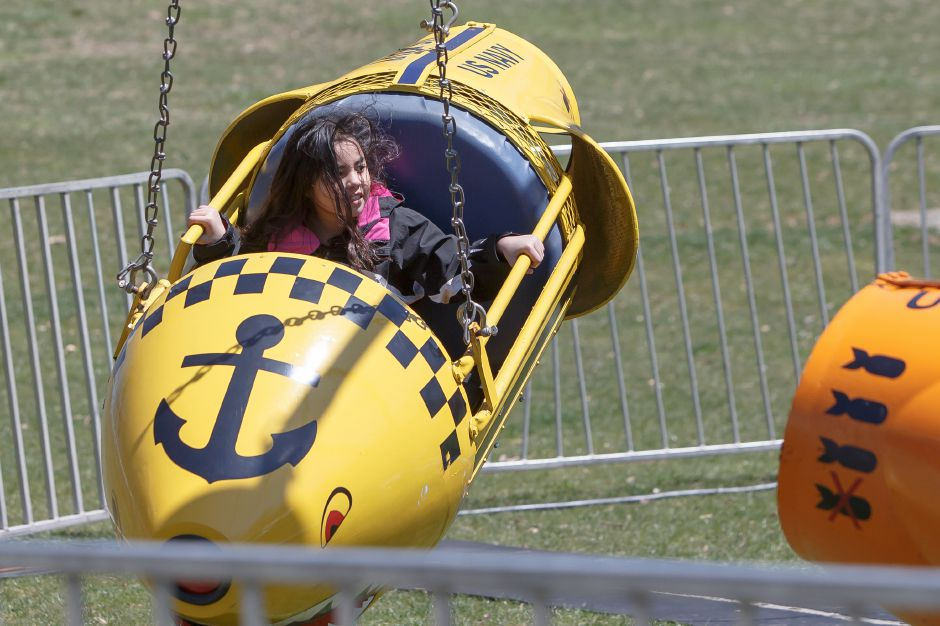 Mia Cortez 7 of Meriden enjoys a carnival ride in the midway Saturday during the Pre Daffodil Festival weekend at Hubbard Park in Meriden April 21, 2018 | Justin Weekes / Special to the Record-Journal