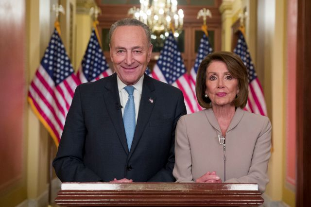 Senate Minority Leader Chuck Schumer of N.Y., and House Speaker Nancy Pelosi of Calif., pose for photographers after speaking on Capitol Hill in response President Donald Trump