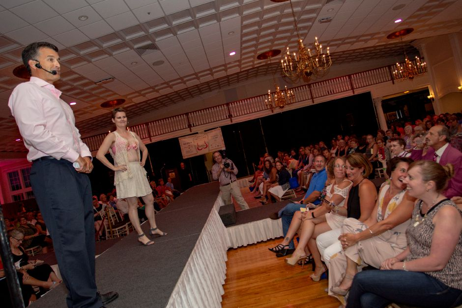 "Auctioneer Tom Gagliardi calls out bids for ""So Many Pearls"" worn by Lynsey Eno during the Art Bra 2018 Runway Show and Auction Aug. 9, 2018 at the Aqua Turf in Southington. 