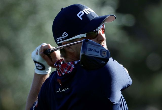 Austin Cook watches his tee shot on the 17th hole during the third round of the CareerBuilder Challenge golf tournament at La Quinta Country Club Saturday, Jan. 20, 2018 in La Quinta, Calif. (AP Photo/Chris Carlson)