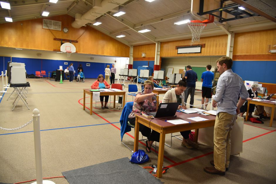 Residents check in to vote on Regional School District 13