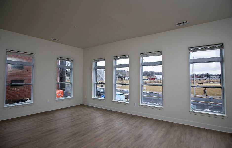 Living room of a three bedroom apartment overlooking the Meriden Green in Meriden Commons l on State Street in Meriden, Friday, Feb. 16, 2018. The developer is accepting applications for the 75 apartments in the complex, expected to open in April. Dave Zajac, Record-Journal