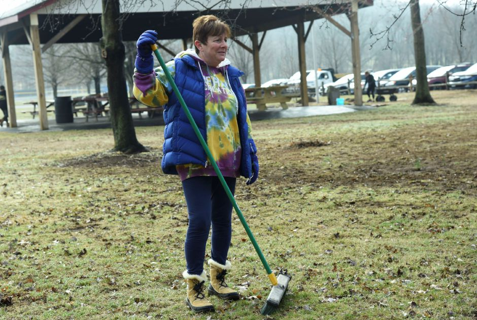 Park and Recreation Director Sherry Hill helps clear Allyn Brook Park during a cleanup event on Saturday, April 6, 2019. | Bailey Wright, Record-Journal