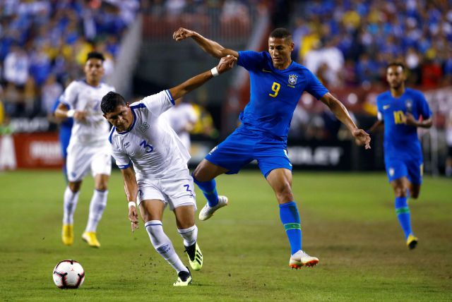 El Salvador defender Roberto Dominguez, left, chases after the ball alongside Brazil forward Richarlison in the first half of a soccer match, Tuesday, Sept. 11, 2018, in Landover, Md. (AP Photo/Patrick Semansky)