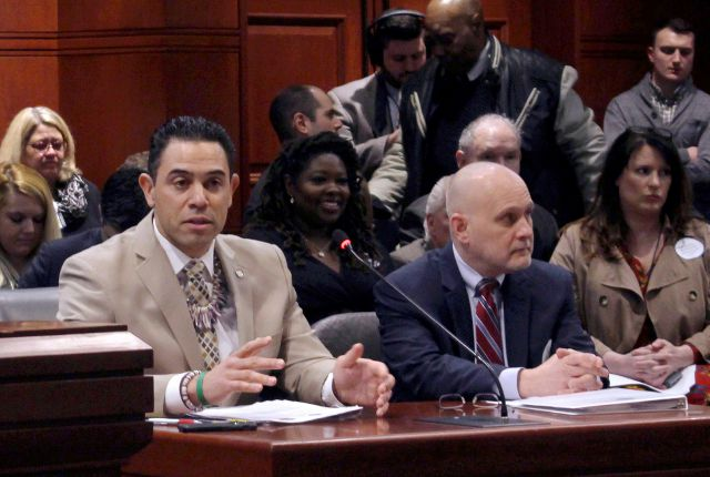 Rodney A. Butler, left, Mashantucket Pequot tribal chairman, sits beside Ray Pineault, right, president and general manager of Mohegan Sun, as he testifies before the General Assembly