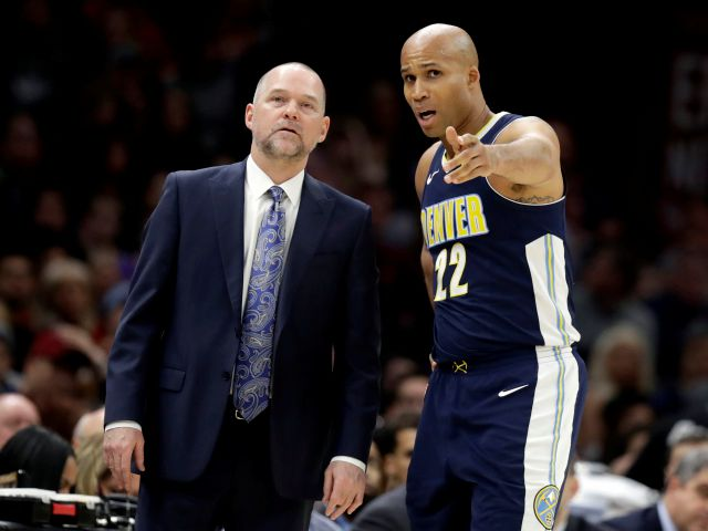 Denver Nuggets head coach Michael Malone, left, talks with Richard Jefferson in the first half of an NBA basketball game against the Cleveland Cavaliers, Saturday, March 3, 2018, in Cleveland. The Nuggets won 126-117. (AP Photo/Tony Dejak)