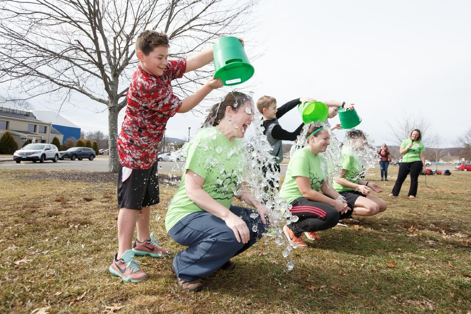 Jacob Rivera 10 left dumps ice water on camp councilor Marcia Arneson Saturday during the 4th Annual Ice Bucket Challenge to raise money for Camp Quinnipiac at Bartlem Park in Cheshire February 24, 2018 | Justin Weekes / Special to the Record-Journal