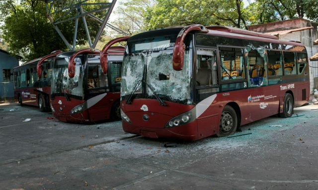 Destroyed public buses sit parked after anti-government protesters attacked them during clashes with soldiers a few blocks from the border bridge in Urena, Venezuela, Sunday, Feb. 24, 2019, on the border with Colombia where Venezuelan soldiers continue to block humanitarian aid from entering. A U.S.-backed drive to deliver foreign aid to Venezuela on Saturday met strong resistance as troops loyal to Venezuelan President Nicolas Maduro blocked the convoys at the border and fired tear gas on protesters. (AP Photo/Rodrigo Abd)