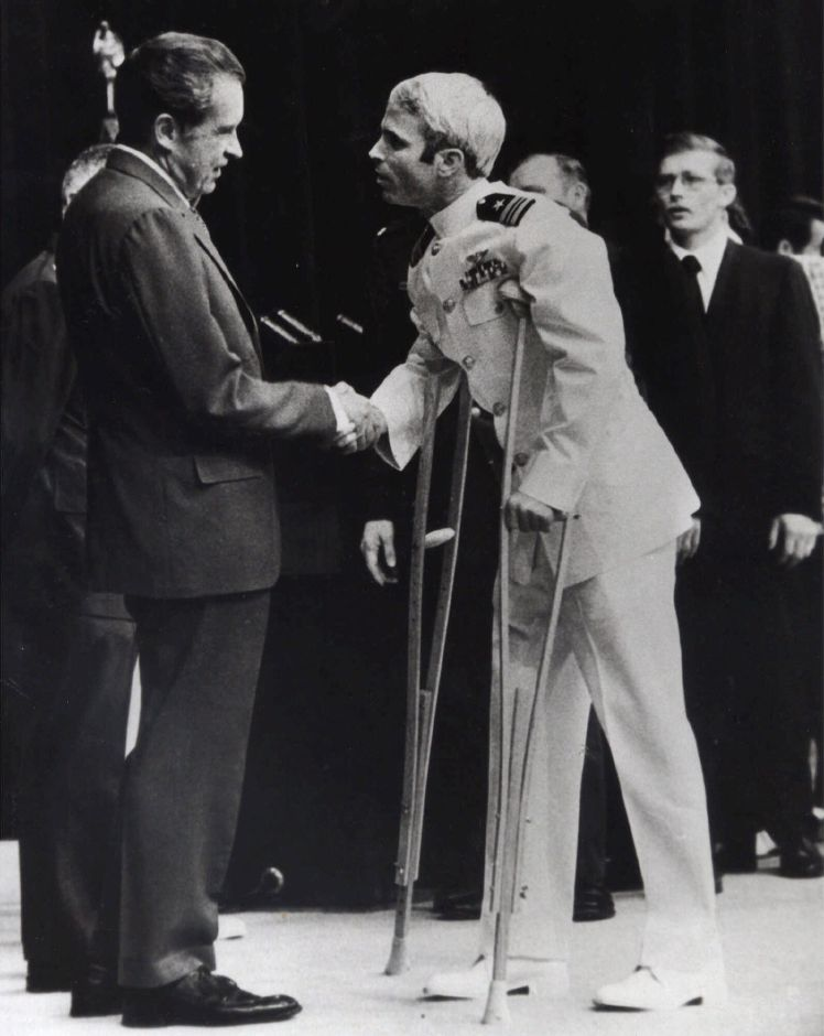John McCain is greeted by President Richard Nixon, left, in Washington, May 25, 1973. McCain spent more than five years in a Vietnamese prisoner of war camp before he was released in March of 1973. (AP Photo/Harvey Georges)