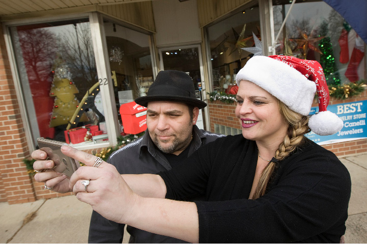 Dana and Erin Canelli-Reig snap a selfie in front of their AJ Canelli Jewelers store decorated for the holidays on Center Street in Wallingford, Thursday, December 8.  | Dave Zajac, Record-Journal