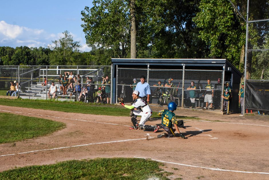 Jack Barry's Devin Rojos scores a run against Ed Walsh on Friday night.