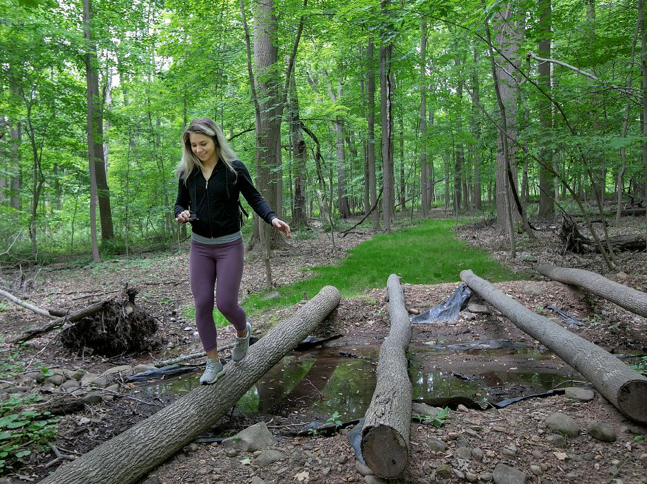 Kristen Dearborn, of Wallingford, steps across an obstacle while touring this year
