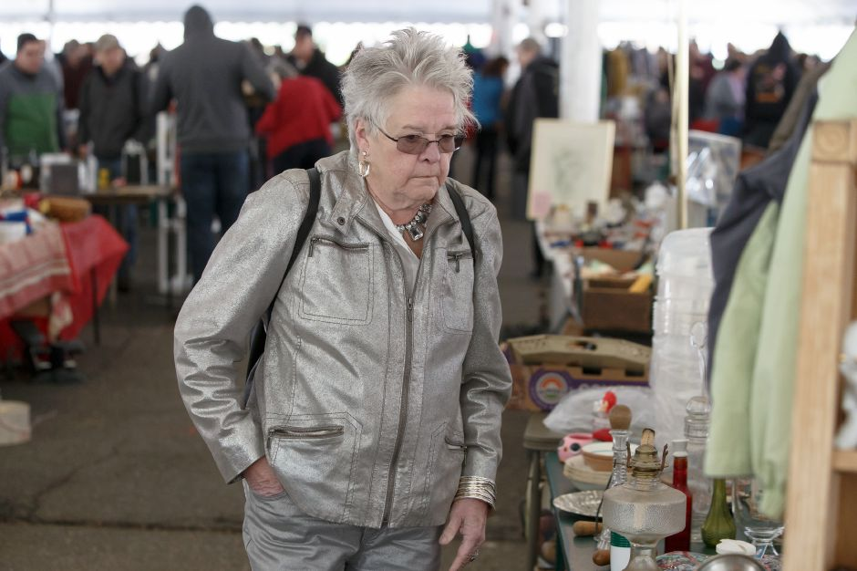 Pat Gilmore of North Haven looks for a deal in the tag sale tent Saturday during the Pre Daffodil Festival weekend at Hubbard Park in Meriden April 21, 2018 | Justin Weekes / Special to the Record-Journal