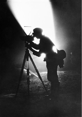 A search light, which forms part of Berlin's air defenses, throws into bold relief this German soldier on duty waiting to give the alarm of the approach of enemy air raiders in Berlin on Sept. 21, 1939. (AP Photo)