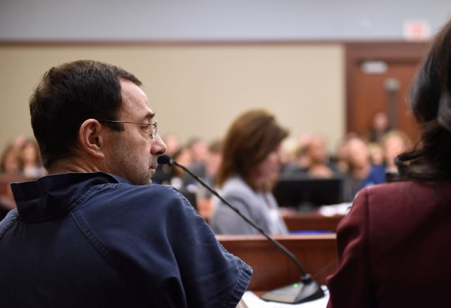 Larry Nassar sits in court during a sentencing hearing Thursday, Jan. 18, 2018, waiting for the third day of victim impact statements to begin, in Lansing, Mich. Nassar, 54, faces a minimum sentence of 25 to 40 years in prison for molesting girls at Michigan State University and his home. He also was a team doctor at USA Gymnastics, based in Indianapolis, which trains Olympians. He