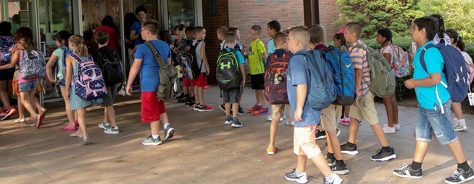 Students head into class during the first day of school at Thomas Hooker Elementary School in Meriden, Monday, August 27, 2018. Dave Zajac, Record-Journal