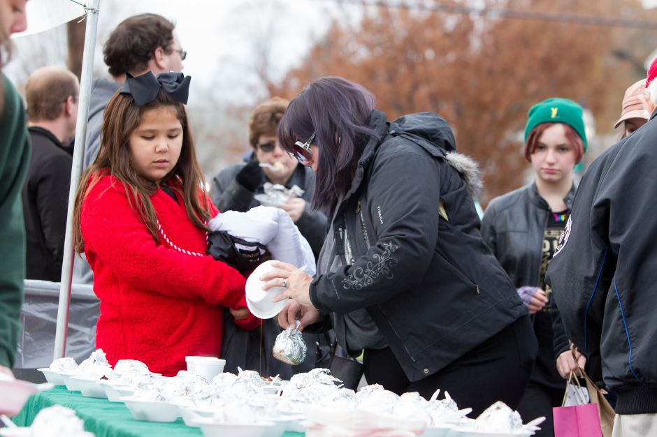 Alex Call 10 and her mom Michelle Otero-Call of Plainville pick out cooked apples Saturday during Christmas in the Village on Main Street in South Meriden December 2, 2017 | Justin Weekes / For the Record-Journal