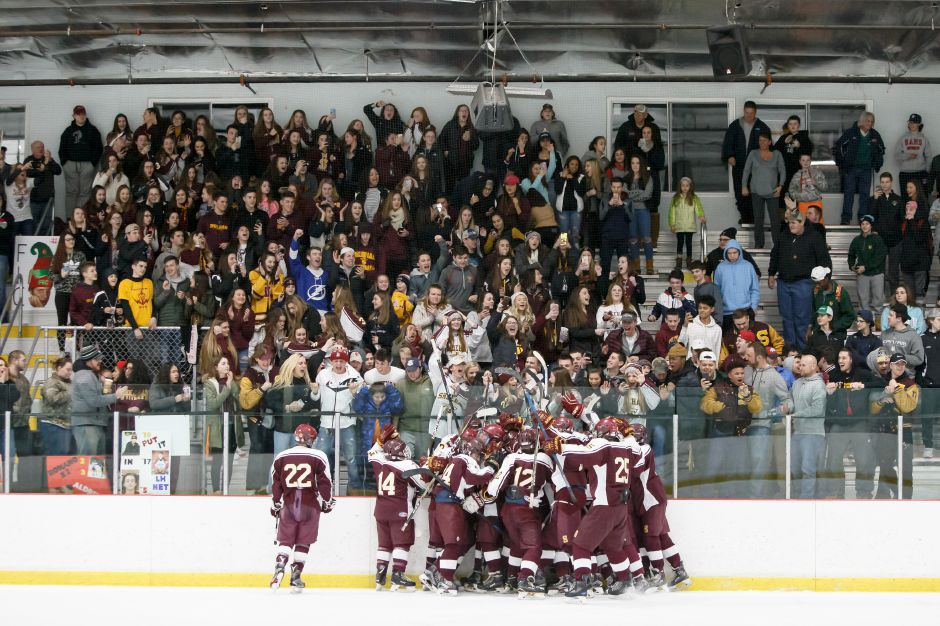 Sheehan celebrates in front of the Titan Pit student section after defeating Lyman Hall H-K Coginchaug in comeback fashion Sunday night at the Northford Ice Pavilion in Northford.