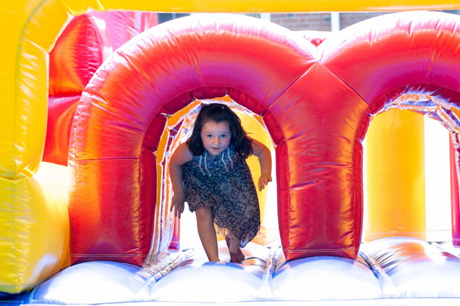 A girl plays on the bounce house at Kensington Congregational Church's Festival on the Hill on June 10, 2017. | Devin Leith-Yessian/Record-Journal