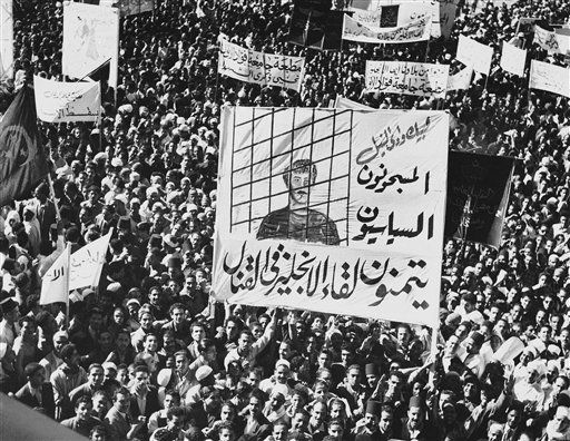 "A huge banner demanding release of political prisoners is carried by Egyptians in a procession through Cairo streets on Nov. 14, 1951 as a three-day ""Hate Britain"" campaign is started. It is part of the Egyptian attempt to get the British out of Egypt and the Egyptians into the Sudan. Most of the political prisoners are members of the Moslem Brotherhood. (AP Photo)"