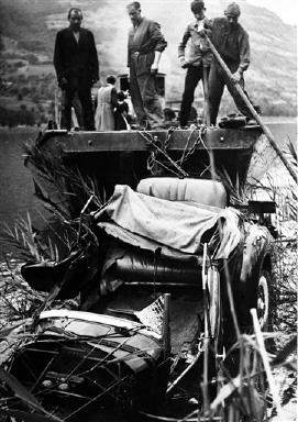 The wrecked car being salvaged from the lake side near Lucerne, Switzerland on August 30, 1935, after the car crash in which Queen Astrid of Belgium was killed whilst driving with her husband the day before. (AP Photo)