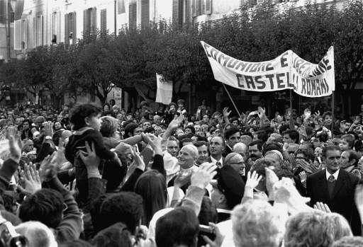 Pope John Paul II waving and smiling as a thick crowd surrounds him on his arrival here today, October 25, 1978, to take possession of his summer residence (Castel Gandolfo). Banner in background reads: Communion and Liberation - Alban Hills, the local branch of a nationwide progressive Catholic organization. (AP Photo)