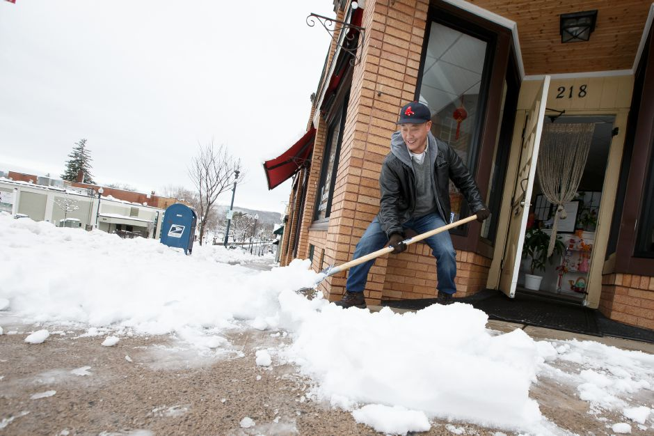 Joe Li removes snow from the side walk in Wallingford Thursday during a winter storm clean-up March 8, 2018 | Justin Weekes / Special to the Record-Journal
