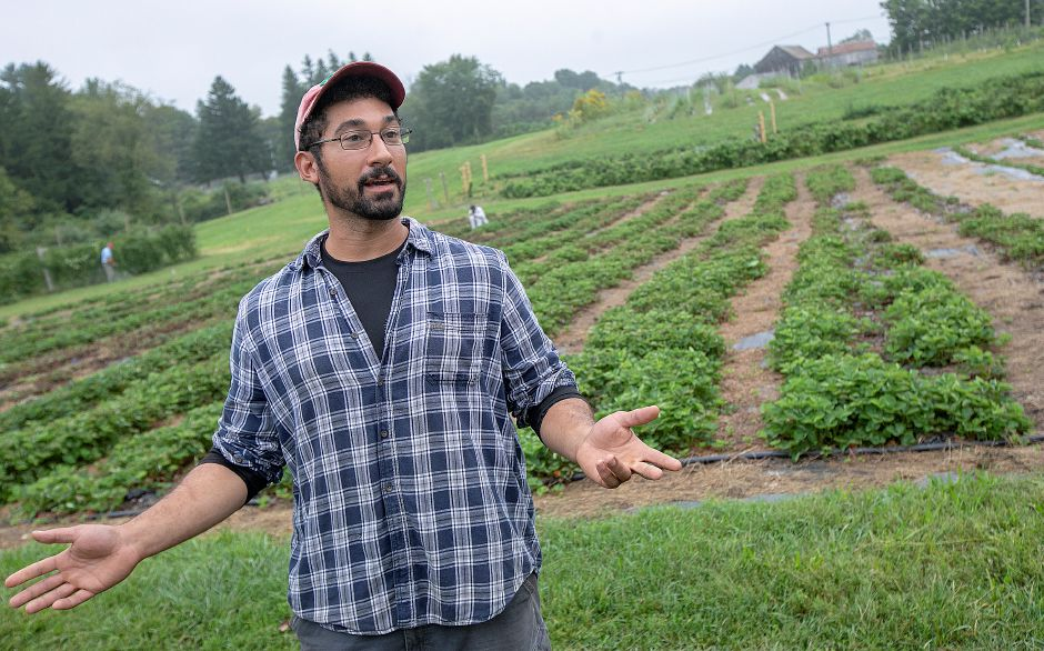 Charles Beasley, farm manager, talks about a variety of fruits and vegetables offered at Old Bishop Farm in Cheshire, Wednesday, Sept. 12, 2018. Dave Zajac, Record-Journal