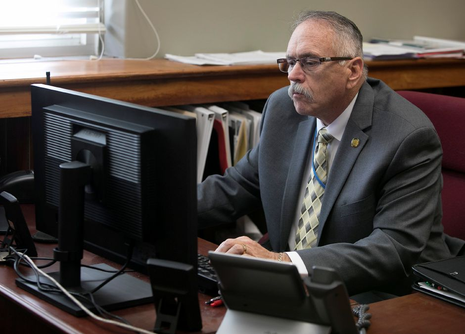 Fire Chief Kenneth Morgan, acting City Manager, works at his desk at Meriden City Hall, Tuesday, Dec. 19, 2017. Dave Zajac, Record-Journal