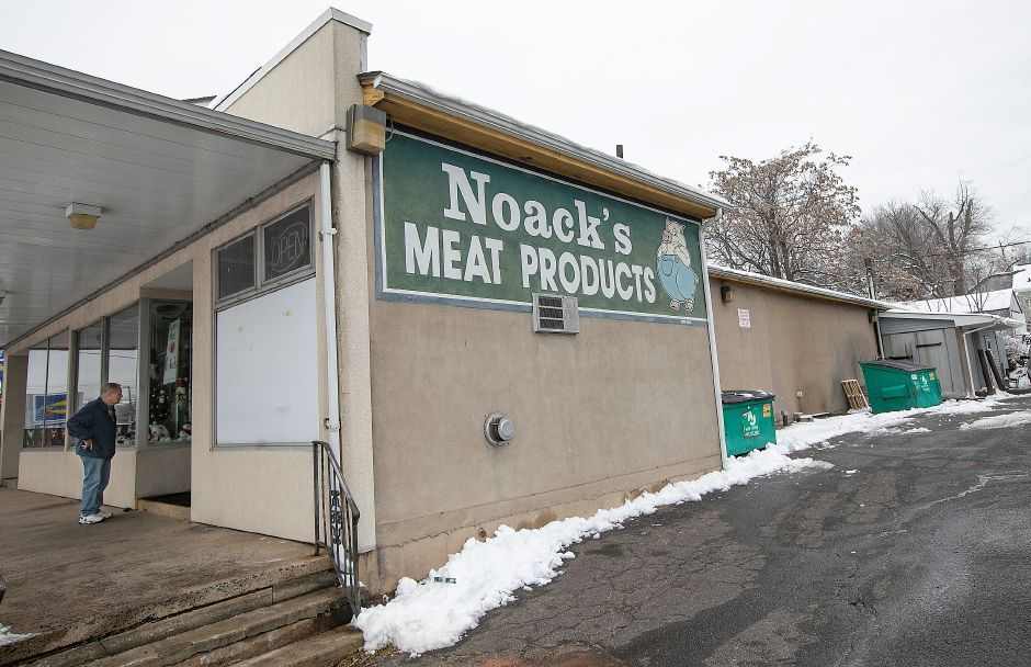 Customer Hans Brings, of Middletown, finds the front door locked at Noack's Meat Products on East Main Street in Meriden on Wednesday. The business is scheduled to reopen today after a fire that occurred in the rear of the building Tuesday night.