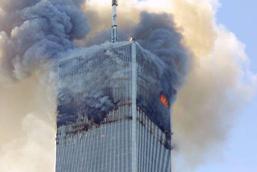 Fire and smoke billows from the north tower of New York
