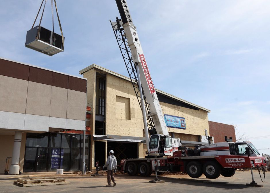 A crane hoists an air conditioning unit onto the roof of Aldi on Route 5 in Wallingford as construction continues there  on Wednesday.