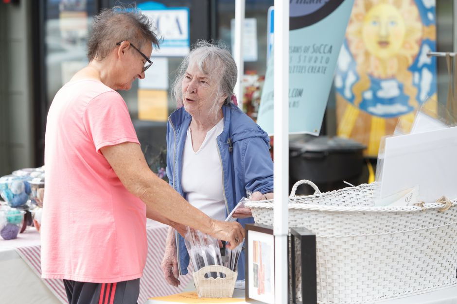 Ulla Budde right of Southington talks with Katie Garstka Sunday during a Summer Sidewalk Sale at Southington Community Cultural Arts Center in Southington July 22, 2018 | Justin Weekes / Special to the Record-Journal