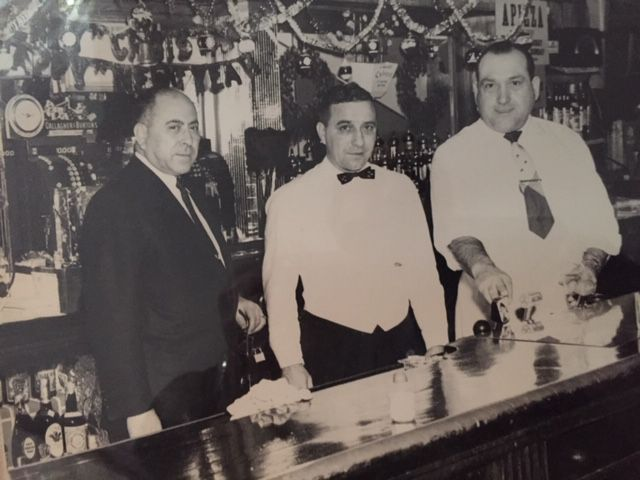 Popular Restaurant owner Horace Secondo, left, with a bartender and waiter.