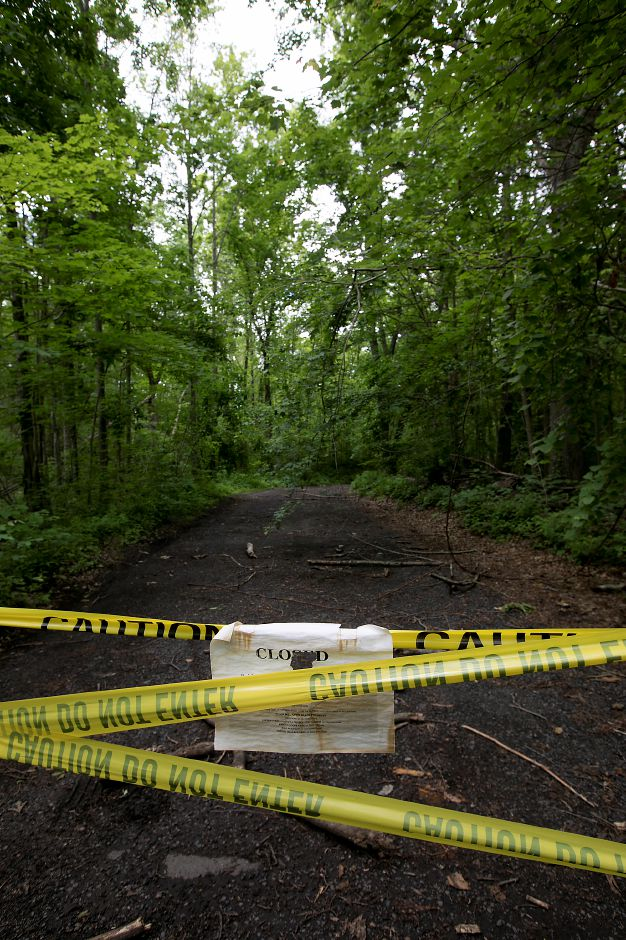 Caution tape blocks the road at Tyler Mill Preserve in Wallingford, Wednesday, June 6, 2018. Tyler Mill Preserve remains closed. Dave Zajac, Record-Journal