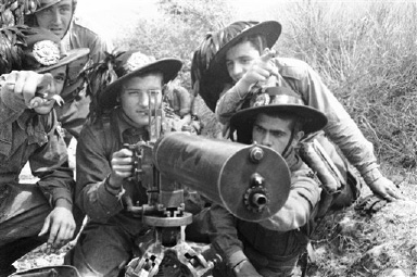 Italian troops with a new type of machine gun during the war manoeuvres near Irpinia, on Aug. 31, 1936. (AP Photo)
