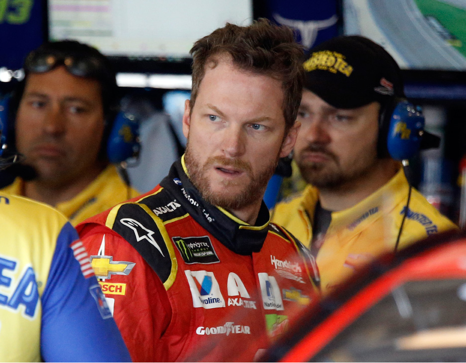 Dale Earnhardt Jr. waits in the garage area prior to the opening practice session for Sunday's NASCAR race at Auto Club Speedway in Fontana, Calif.| Associated Press