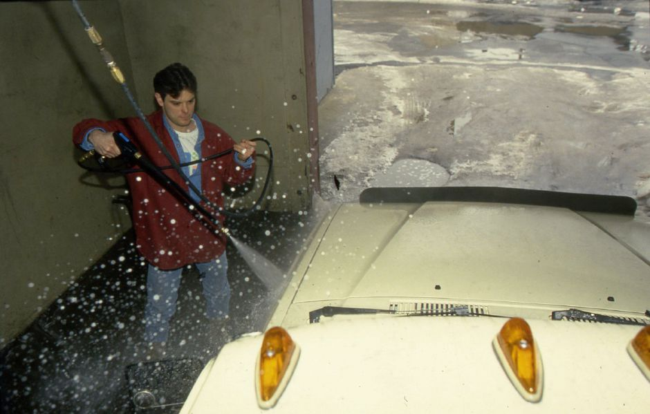 RJ file photo - Mark Perrin of Meriden found time - and warmer temperatures - to clean his truck at C&C Car Wash Jan. 25, 1994.
