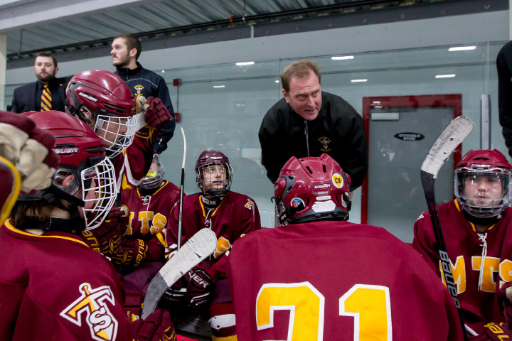 With head coach Dave Festa (center) on a business trip, Sheehan hockey is in the hands of assistants Jerry Maust, Ryan Kiernan and Cody Albert. Each is a former Sheehan player. | Justin Weekes / For the Record-Journal