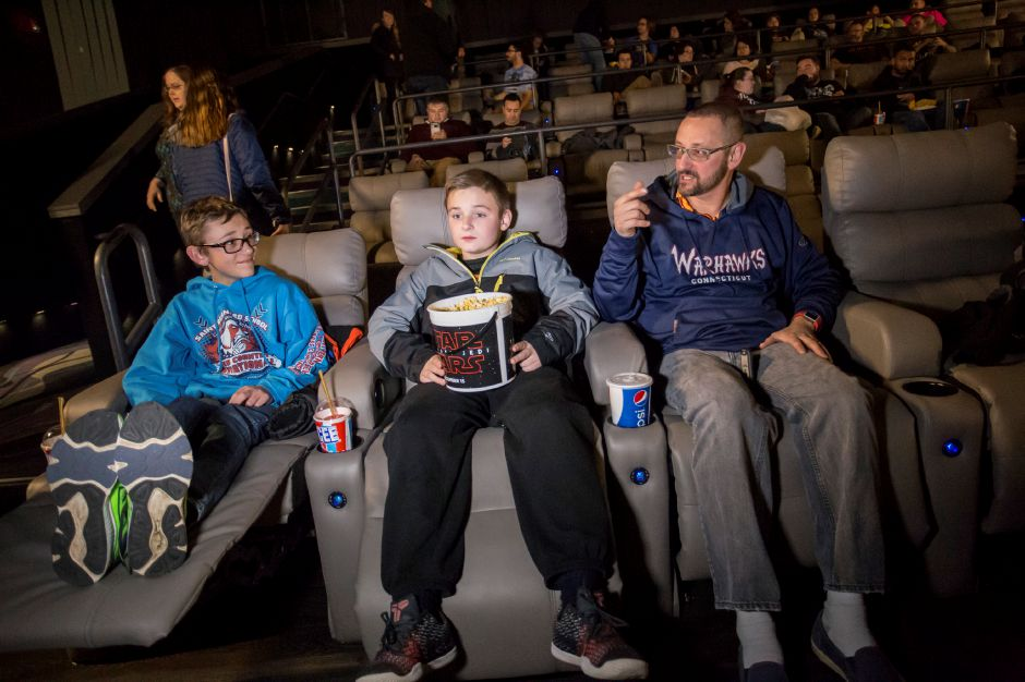 Brody Santagata, left, Luciano Frezza, center, and Brody Santagata discuss Star Wars ahead of the Star Wars: The Last Jedi premiere at Holiday Cinemas in Wallingford Dec. 14, 2017. | Richie Rathsack, Record-Journal staff
