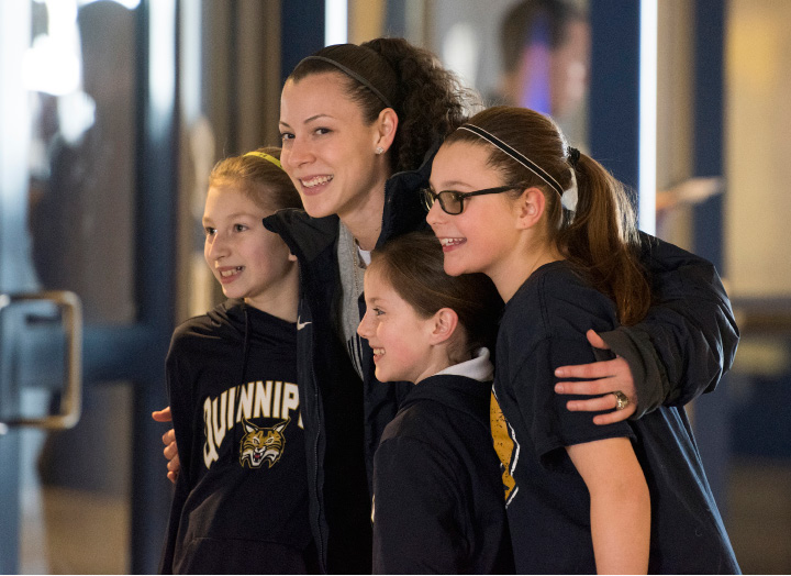 Adily Martucci, a senior guard from Waterford, Connecticut, poses with young fans.| Photo courtesy of Autumn Driscoll/Quinnipiac University
