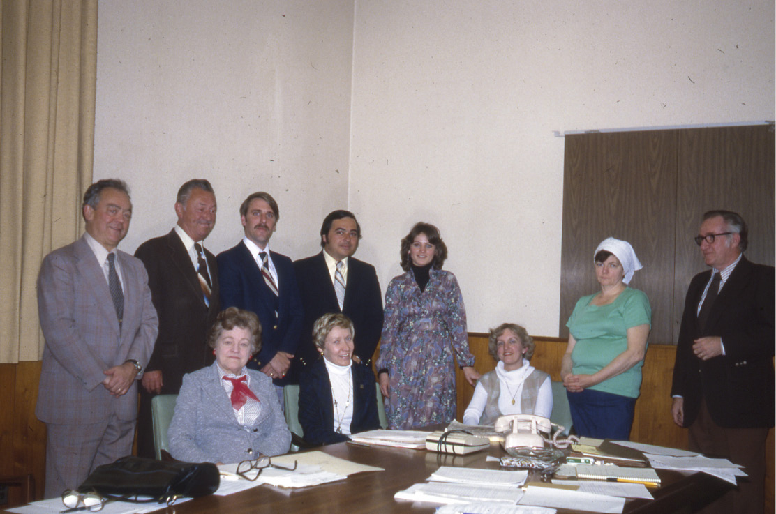 File photo - Record-Journal Publisher Carter White (standing, far left) at a  meeting with city and business leaders to discuss the Daffodil Festival in 1979.