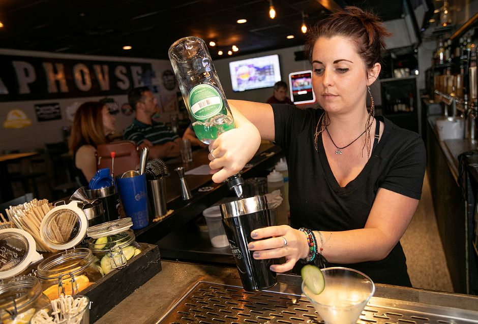 "Bartender Sarah Cope creates the cocktail ""The Color of Money"" at Sherman's Taphouse, 25 Center St., Southington, on Tuesday."