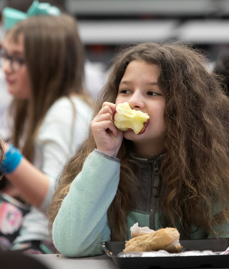 Student Emily Vegliante, 10, bites into an apple during lunch break at Israel Putnam Elementary School in Meriden, Thursday, Feb. 8, 2018. Dave Zajac, Record-Journal