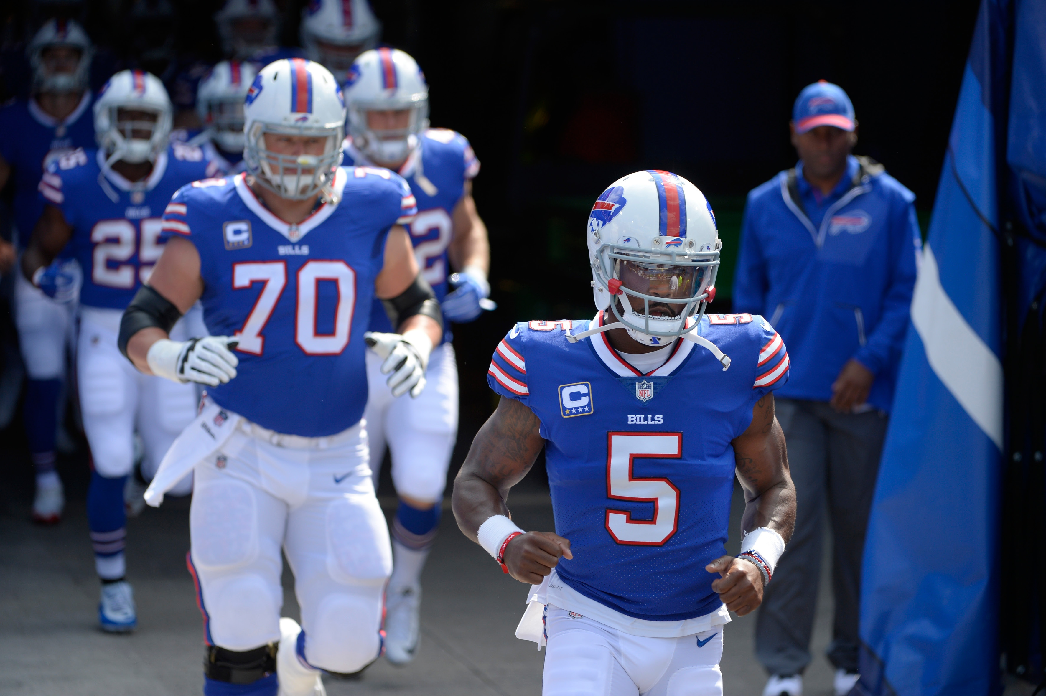 Buffalo Bills quarterback Tyrod Taylor (5) takes the field with teammates before an NFL football game against the New York Jets Sunday, Sept. 10, 2017, in Orchard Park, N.Y. (AP Photo/Adrian Kraus)