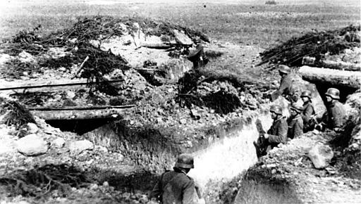 German Nazi soldiers are shown in Soviet trenches that they stormed and captured from the Communists near Leningrad during World War II.  This Oct. 19, 1941 photo was passed by the German censor.  (AP Photo)