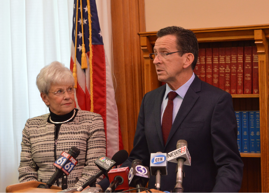 Gov. Dannel P. Malloy speaks to reporters after announcing an agreement Friday afternoon that would avoid a looming spike in pension costs that threatens to choke the state's budget over the next 15 years. | Mike Savino, Record-Journal