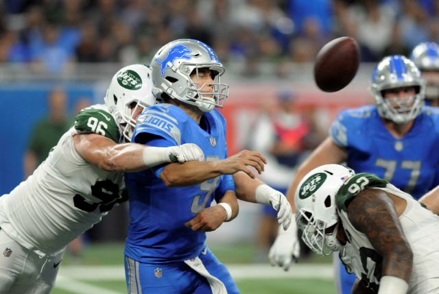 New York Jets defensive end Henry Anderson (96) hits Detroit Lions quarterback Matthew Stafford