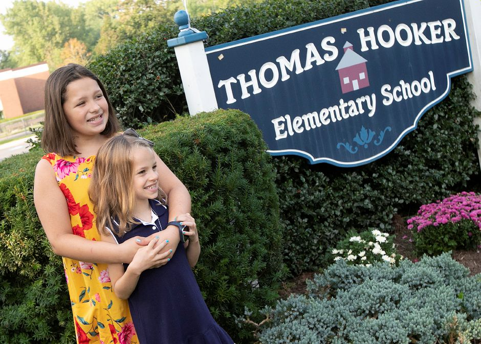 Addison Markoja, 10, and sister, Kaylee, 7, pose for photos during the first day of school at Thomas Hooker Elementary School in Meriden, Monday, August 27, 2018. Dave Zajac, Record-Journal
